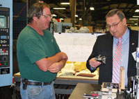 Employee David Gay and Governor LePage in the shop